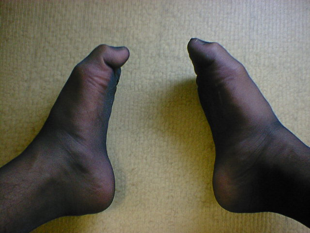 My two stockinged feet on floor