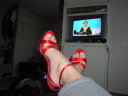 Sexy red heels while watching TV